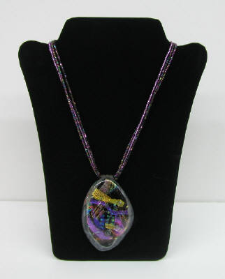 Artist: Marcia Fossey, Title: Fused Glass Pendent w/ Purple and Gold - click for larger image